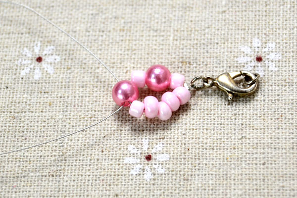 Picture Of spring inspired diy pink beads and pearls bracelet  3