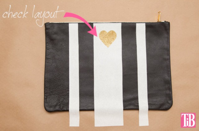 Picture Of striped diy leather clutch with a heart pattern  4