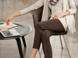 a casual work outfit with grey pants, a creamy top and duster, grey flats and a matching necklace