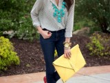 navy skinnies, a polka dot blouse, a statement necklace, a large yellow clutch and red flats