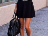 a printed top, a black A-line mini, black flats and a black bag for a girlish feel in your look