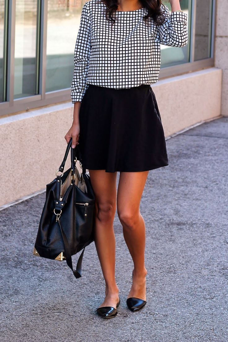 a printed top, a black A line mini, black flats and a black bag for a girlish feel in your look