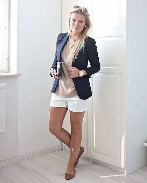 a summer work look with white shorts, a tan top, a navy blazer, brown flats and a clutch