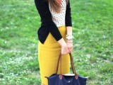 a polka dot top, a black cardigna, a mustard pencil skirt, leopard flats and a navy bag