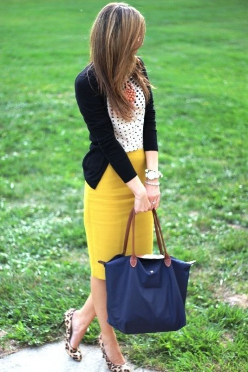 a polka dot top, a black cardigna, a mustard pencil skirt, leopard flats and a navy bag