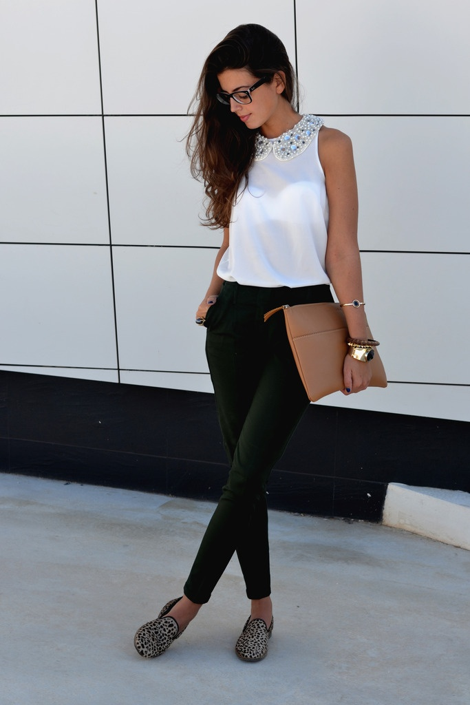 a simple and chic outfit with green pants, a white sleeveless top with an embellished collar, leopard flats and a brown clutch