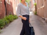 a printed blouse with a V-neckline and wide sleeves, navy skinny pants, metallic flats and a black tote