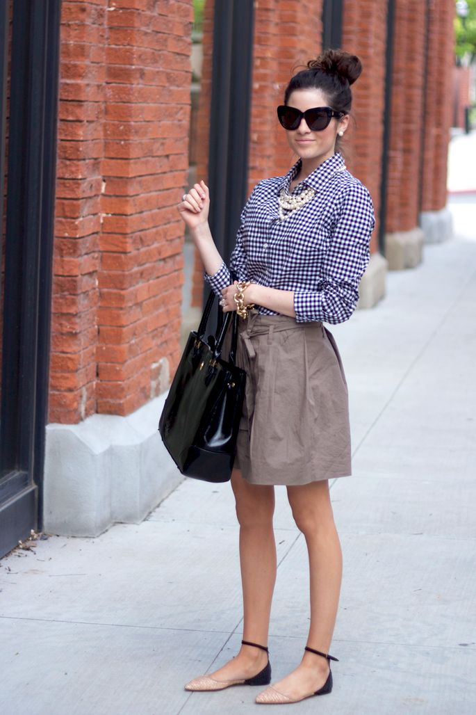 a blue and white gingham button down, a statement pearl necklace, a black tote and blush and black flats