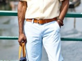 a creative summer work look with light yellow shirt with rolled up sleeves, white pants, espadrilles and a yellow laptop bag