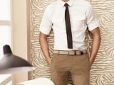 tan pants, a white shirt with rolled up sleeves and a brown tie for an everyday work look