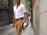 tan linen pants, a white shirt with short sleeves, brown moccasins and a white hat for a hot summer workday