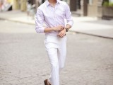 a pink shirt, white pants, brown moccasins and sunglasses for a summer working day