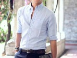 navy pants, a light blue linen shirt with rolled up sleeves for a summer working day