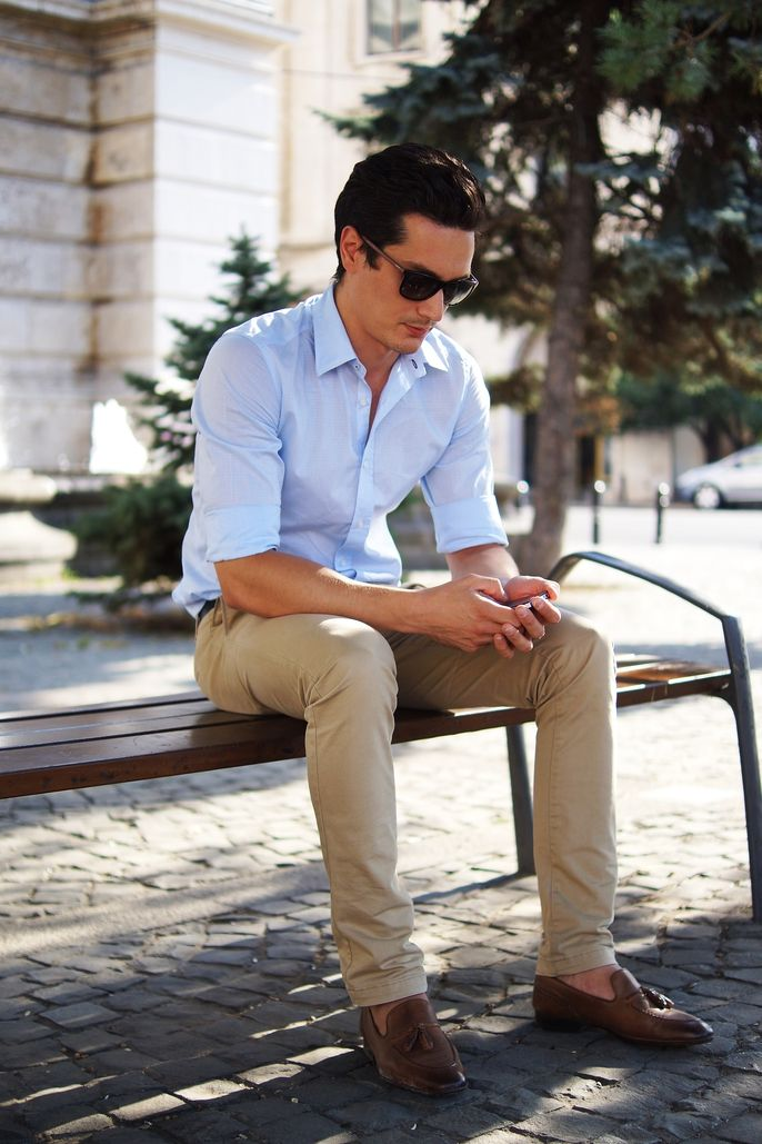 a blue shirt, tan pants, brown moccasins for a simple and casual summer work look