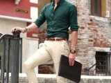 a hunter green shirt with rolled up sleeves, neutral pants, brown moccasins for a summer work look