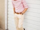 a pink striped shirt with cuffed sleeves, neutral pants, brown shoes for a light summer work look