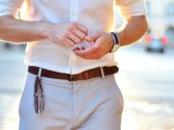 a summer work look with a white shirt with cuffed sleeves and grey pants plus a brown belt is an easy and cool combo