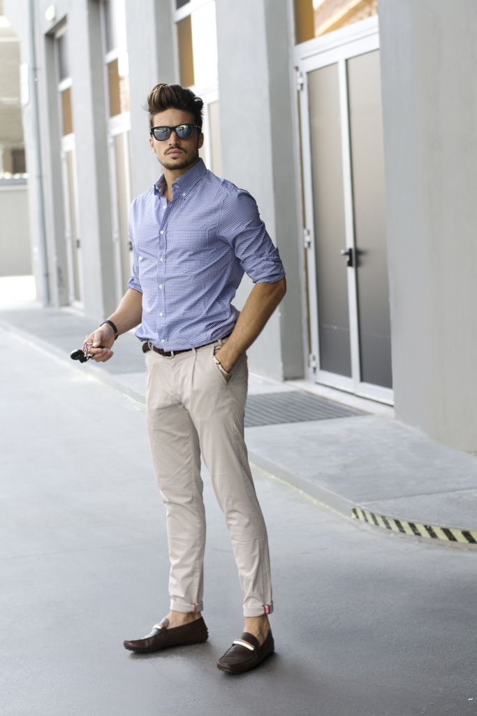 a summer work look with a blue printed shirt, creamy pants, brown moccasins for every day