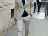a neutral blazer and pants, a navy tee, brown shoes with no socks for an elegant summer work look