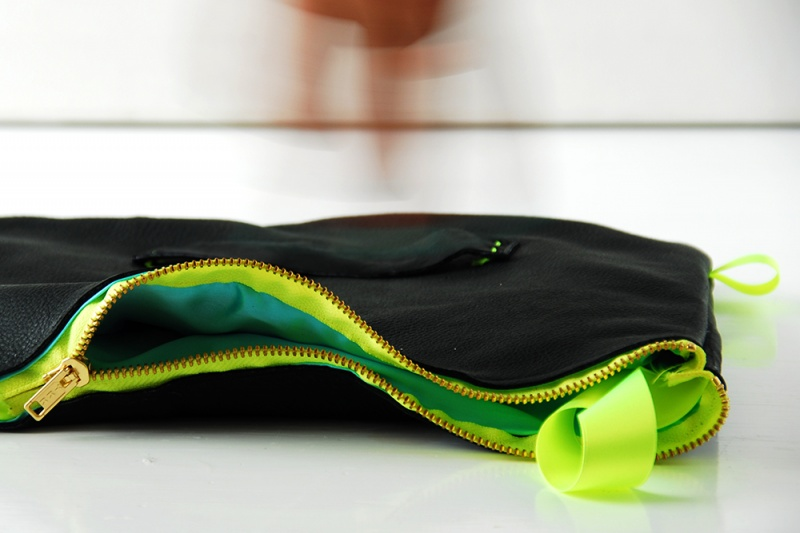 leather clutch with a neon zipper