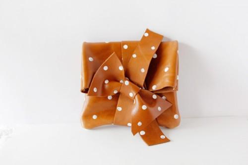 polka dot leather clutch (via seekatesew)