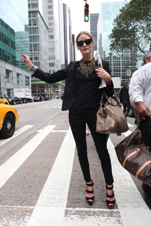 black skinnies, a black top, strappy shoes and a black blazer plus a statement necklace show off your legs at their best