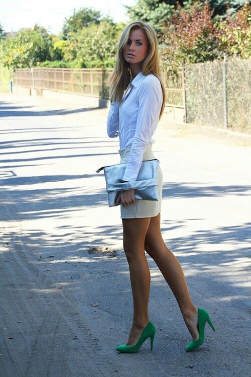 a white button down, neutral shorts to show off your legs, a metallic clutch and green shoes