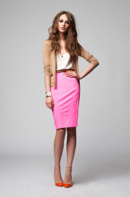 a neutral top, a playful hot pink pencil knee skirt, a camel cardigan, orange shoes that add color and boldness