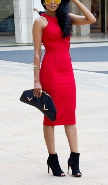 a red halter neckline bodycon midi dress, peep toe boots and a black clutch to rock