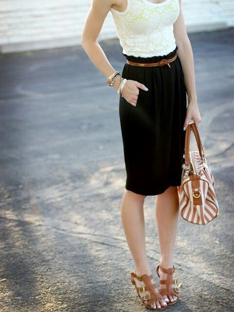 a lace sleeveless top, a black knee skirt and tan shoes to show off your legs and a tan plus cream bag
