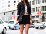 black mini shorts will highlight your legs, a polka dot top, a black blazer, creamy strappy shoes and a black clutch