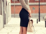 a navy pencil mini, a neutral long sleeve top, fuchsia ankle strap shoes and a creamy bag