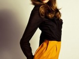 a mustard midi pencil skirt plus a sheer black blouse make up a contrasting and bold look